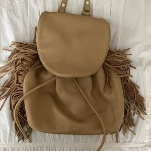 Drawstring closure backpack purse with tassel